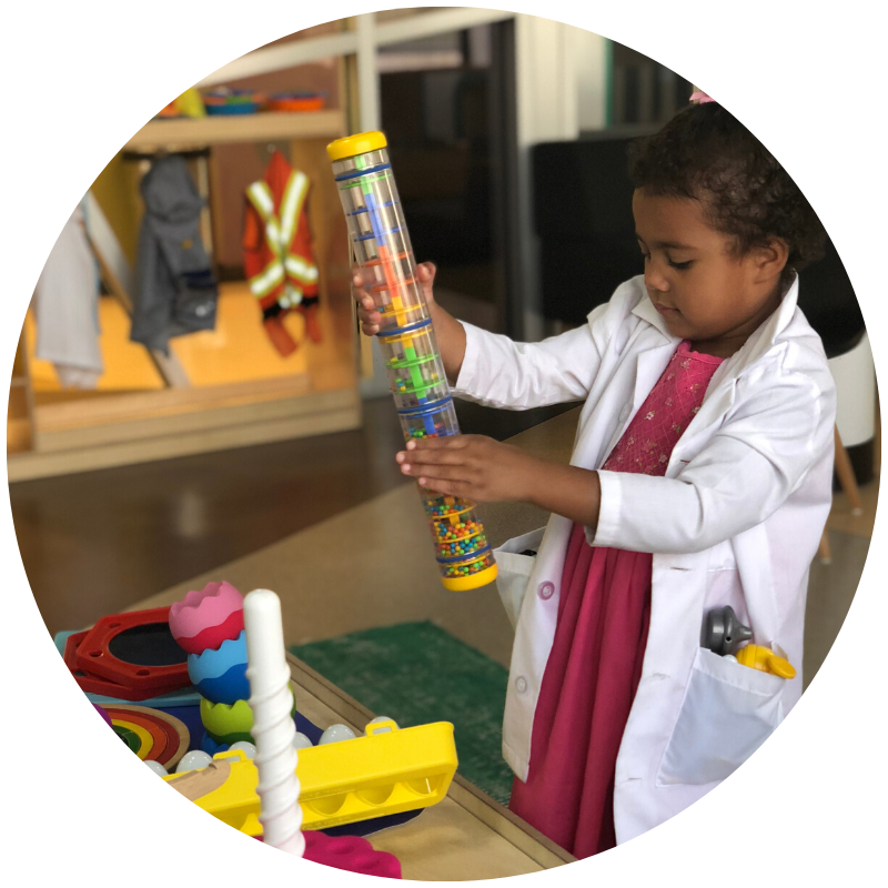 Child scientist having fun at museum